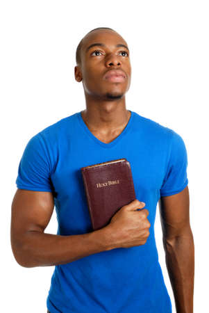 This is an image of student holding a bible looking up. Stock Photo - 9425204