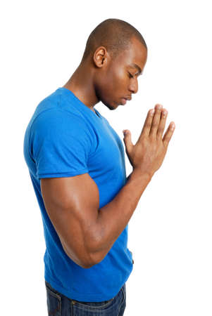 orando: Se trata de una imagen de un estudiante orando. Foto de archivo