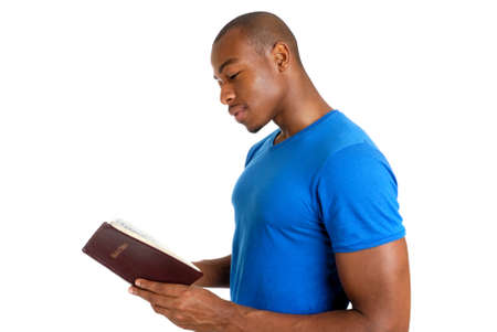 bible book: This is an image of young man studying the bible.