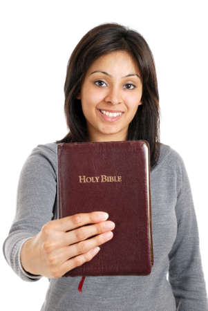 This is an image of young woman holding a bible showing commitment. Stock Photo - 9425214