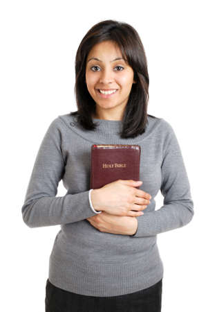 christian women: This is an image of young woman holding a bible showing commitment.