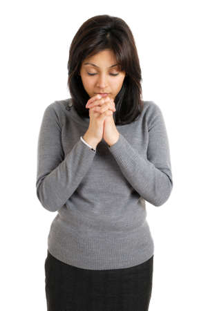This is an image of young woman praying.