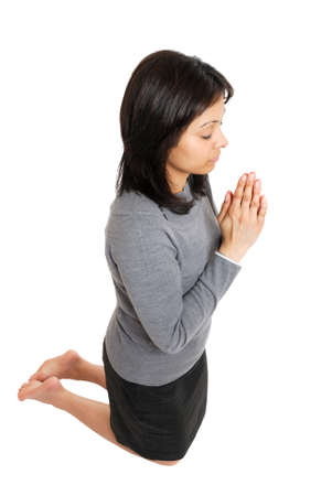 This is an image of business woman kneeling and praying. Stock Photo