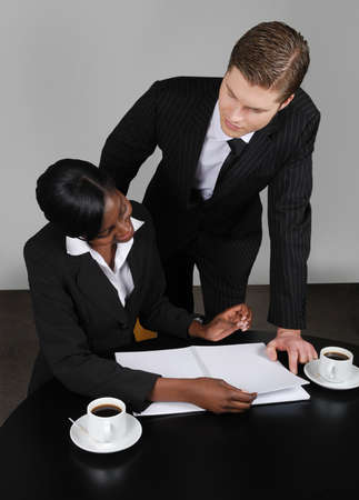 This is an image of a multi ethnic business team planning ahead. Stock Photo - 9436533