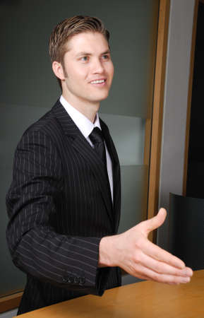 This is an image of a business man offering a handshake.