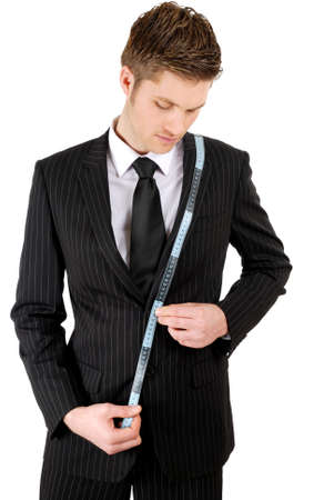 tailor measuring tape: This is an image of a business man using a measuring tape. Stock Photo