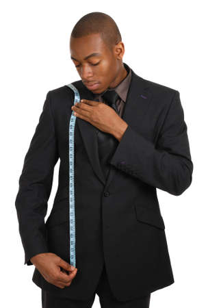 This is an image of a business man using a measuring tape. photo
