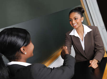 black handshake: This is an image of a business team having a discussion. Stock Photo