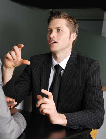 debate win: This is an image of a business man having a discussion.