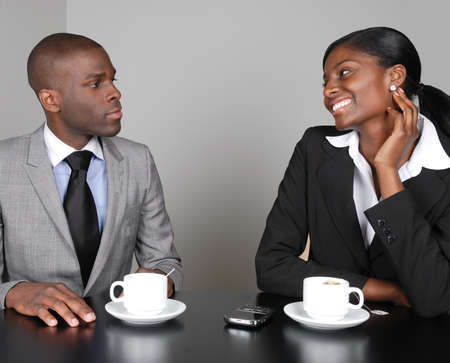 debate win: This is an image of a business team having a discussion. Stock Photo