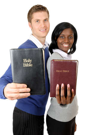 This is an image of a business couple holding up bibles