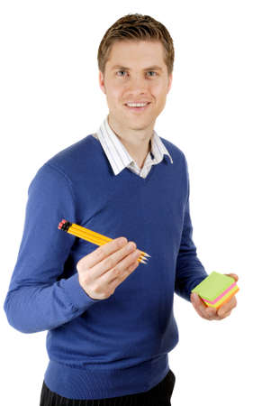 This is an image of business man holding a pack of pencils about to write on a pack of post its.