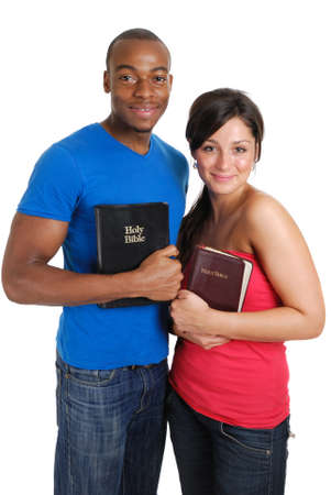 committed: This is an image of a student couple holding bibles.
