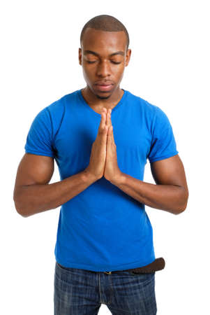 This is an image of male student doing a prayer gesture. Stock Photo