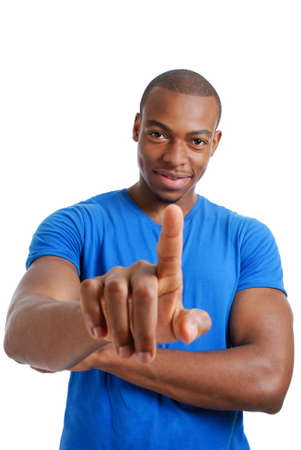 This is an image of confident male student pointing.   Stock Photo