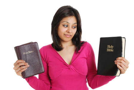 This is an image of female student holding two bibles.