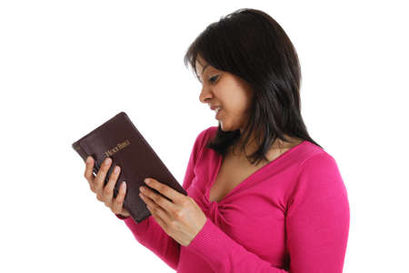 This is an image of a woman reading the bible.