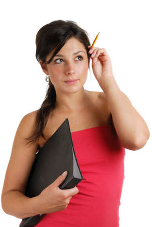 This is an image of female student holding a folder and pencil. photo