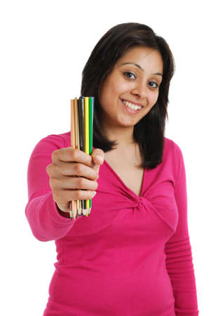 This is an image of a female student holding a bunch of pencils. photo