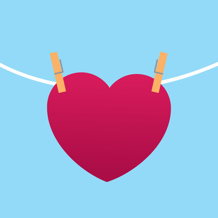 Heart clipped to string with blue background