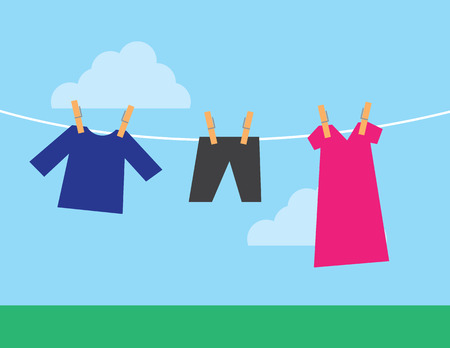 A few clothes hanging from a clothesline