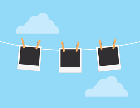 Photos hanging from string with sky background Illustration