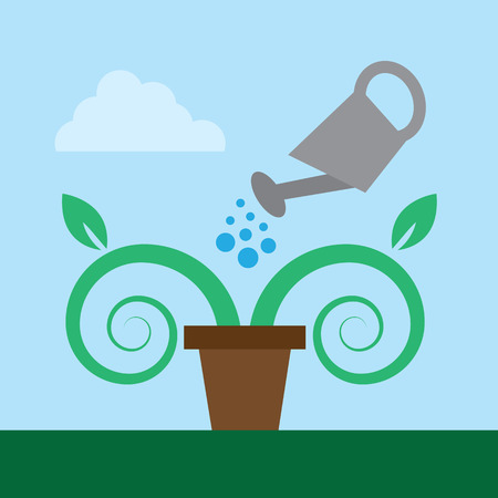Watering can and potted plant