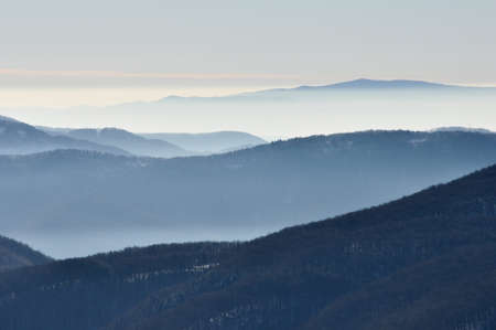 View on the Bieszczady mountains, Poland in winter fog.