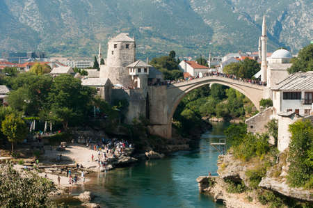 Mostar bridge with mountains in background, Bosnia and Herzegovina on summer.