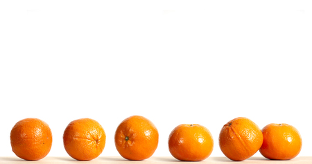 Variation of ripe oranges fruit on wooden table with white background for advertising - commercial