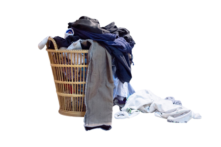 Overflowing laundry basket on white background