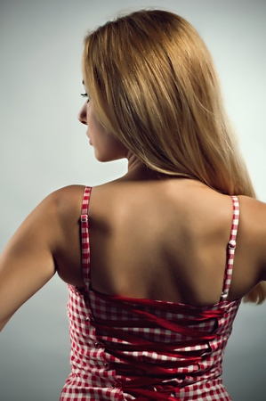 Blond girl in red-white corset photo