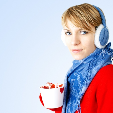 Girl holds cup of hot chocolate.  photo