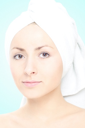 Beautiful girl with a towel around her head