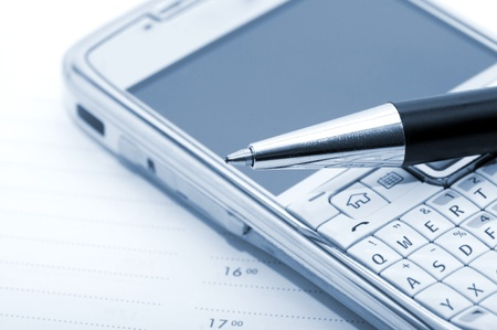 Pen, mobile phone and planner