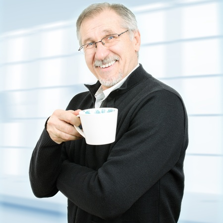taking a break: Senior businessman taking a break  Isolated with clipping path