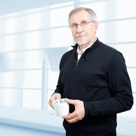 older person: Senior businessman having a break Stock Photo