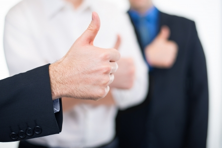 Businessmen gesturing thumbs up Stock Photo