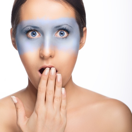 Surprised blue eyed girl with blue mask Stock Photo