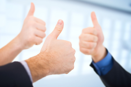 Businessmen Gesturing Thumbs up. Business Concept. Stock Photo