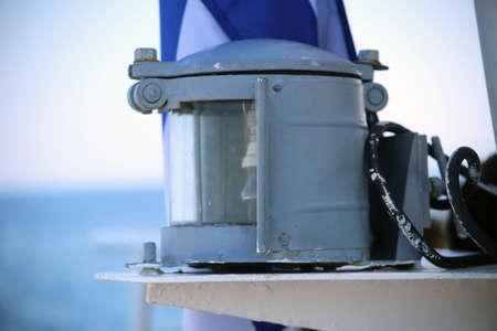 The navigational white light of a passenger ship. White, bright, white, light, ship.
