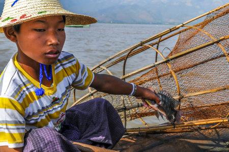 inle: Small Fisherman on Inle Lake Editorial
