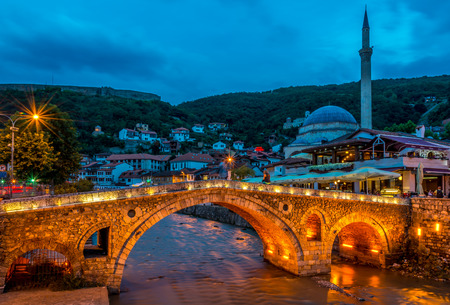 PRIZREN, KOSOVO - JULY 27,2014 - Evening view at the old stone bridge in Prizren  Prizren is a historic city located in Kosovo