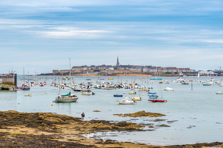DINARD, FRANCE - AUGUST 24,2014 - View at Saint Malo from Dinard. Its beaches and mild climate make it a popular holiday destination.