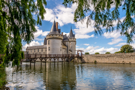 sully: SULLY SUR LOIRE, FRANCE - AUGUST 26,2014 - View at the chateau Sully sur Loire across moat .The chateau of Sully sur Loire dates from the end of the 14th century and is a prime example of medieval fortress. Editorial