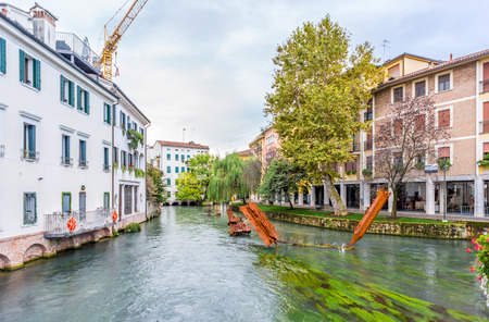 treviso: TREVISO,ITALY - SEPTEMBER 13,2014 - Metal sculptures in water canal of Treviso. Treviso stands at the river Sile in region Veneto. Editorial