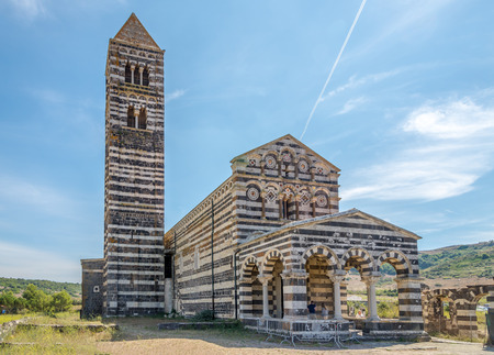 CODROGIANOS,ITALY - SEPTEMBER 16,2014 - Basilica Holy Trinity of Saccargia. The construction is entirely in local stone black basalt and white limestone, with a typical appearance of Tuscan Romanesque style.