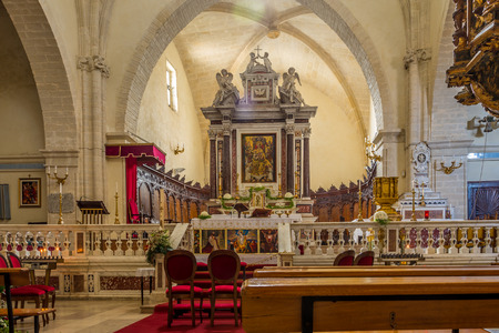 predominantly: CASTELSARDO,ITALY - SEPTEMBER 21,2014 - Inside of cathedral Sant Antonio Abate in Castelsardo.The interior is predominantly Gothic, but it underwent numerous remodelling projects that changed its original appearance.