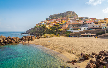characterised: CASTELSARDO,ITALY - SEPTEMBER 21,2014 - Beach in Sardinian Castelsardo.The coastline of Castelsardo is characterised by the trachytic rock typical of the zone and thus offers many rocky reefs overlooking the sea.