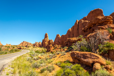 geologists: Rock Formations near road in Arches National Park Stock Photo